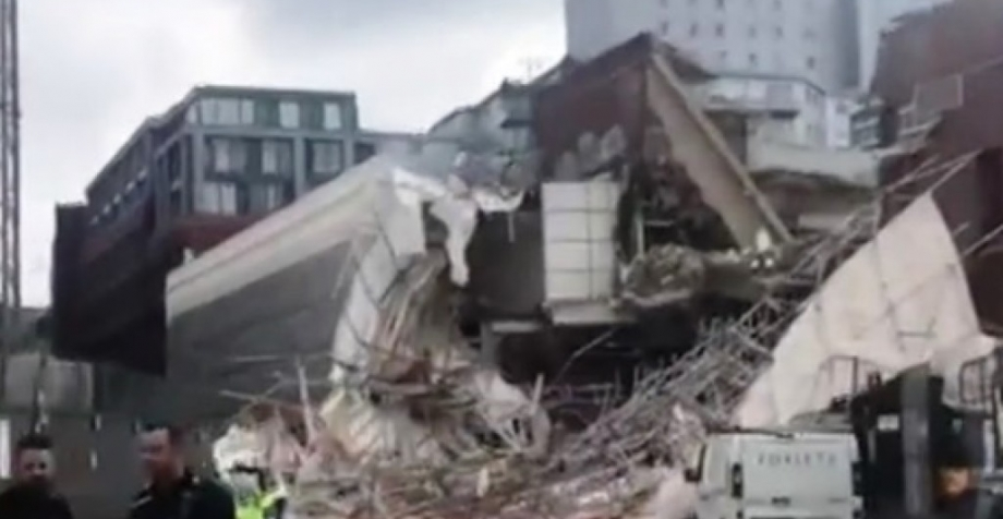 Three people were injured when a large scaffolding collapsed at a Reading town centre demolition site yesterday.
