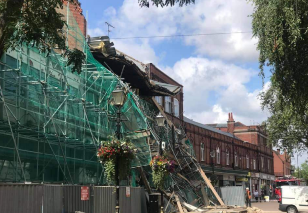 Part of an old Co-op building in Nuneaton collapsed during demolition work on Wednesday bringing down scaffolding